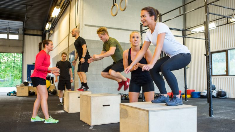 Group training CrossFit with box jumps